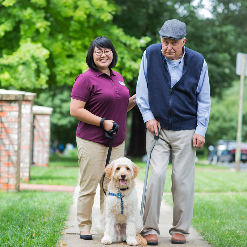 CAREGiver-and-senior-male-walking-dog_800x800